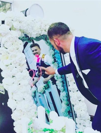 Groom using the booth