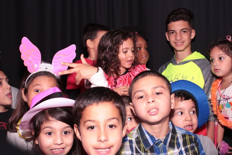 The Younger wedding guests enjoying the photo booth provided by Photo Booth Image. Naperville IL.