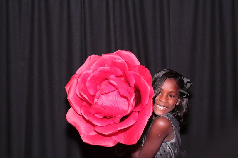 Robinson wedding photo booth, Alison Brown pictured with a very large rose at the Marriott hotel Oak...