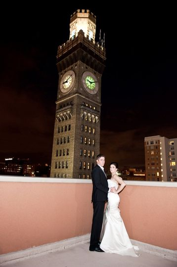 Couple portrait by a clock tower