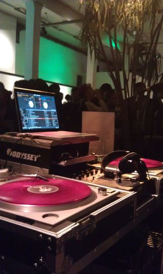 Spin records at the DJ booth