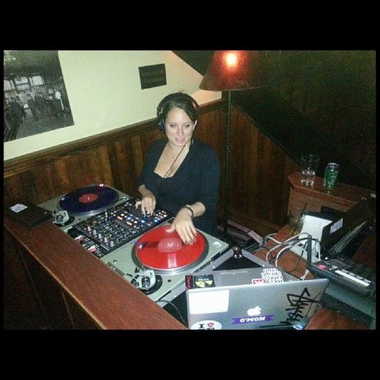 Spinning records behind the DJ booth
