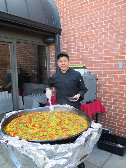 Chef Luis is using a 4 foot pan to cook Paella de Verduras for 30 people