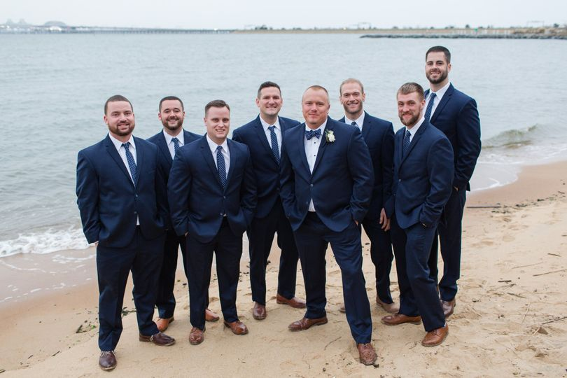 The groom and his groomsmen in navy blue