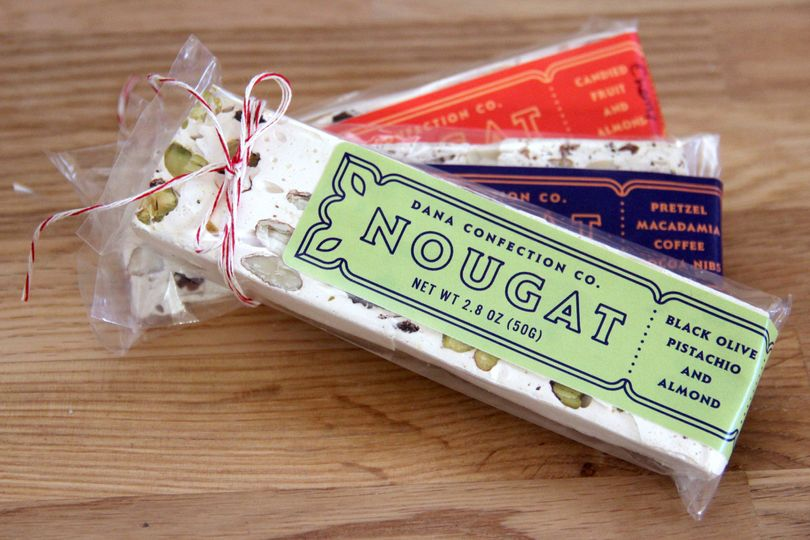 Our french-style nougat comes in three flavors: Black Olive Pistachio Almond, Candied Fruit Almond,...