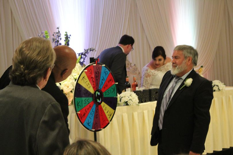"A twist on the ""clinking couples"" kissing game... Spin the wheel!"