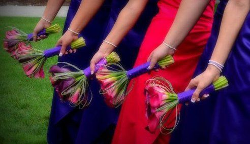 Hot Pink and Grape Callas accented with bear grass.