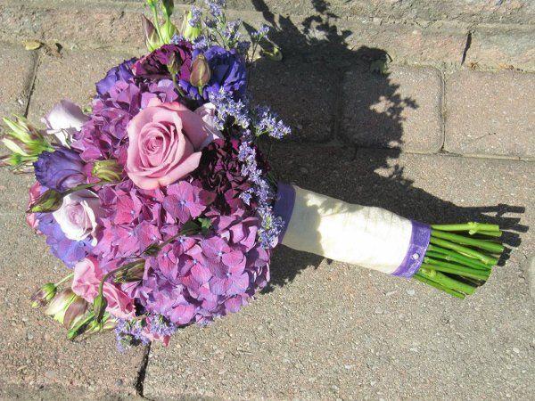 Purple Hydrangea, Lavender Roses, Purple Lisianthus, Ocean Spray Roses and Limonium.