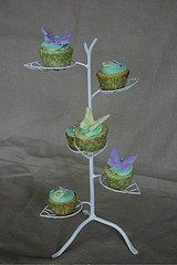 Cupcakes can not only be part of the event's menu, but may also serve as decor.  Miniature cupcakes...