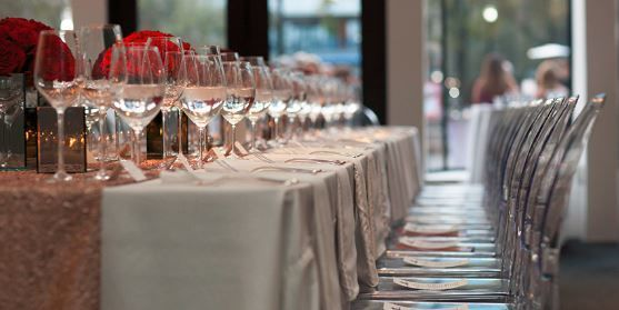 Wine glasses prepped for the reception