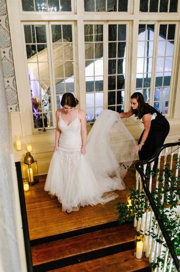 Owner Helping Bride