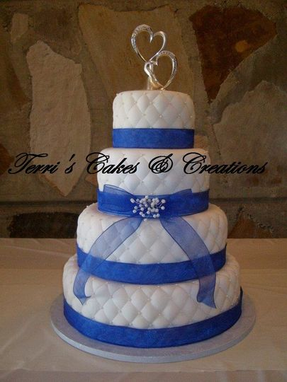 French vanilla cake, top & bottom tiers Bavarian cream filling, 2nd tier chocolate Bavarian filling,...