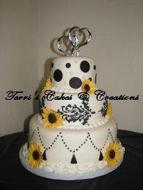 White cake w/chocolate Bavarian cream filling, raspberry filling, & Bavarian cream filling, covered...