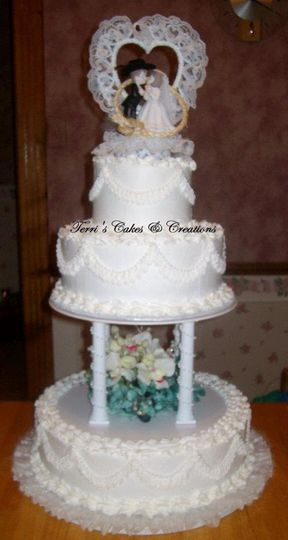 French vanilla cake w/strawberry filling, buttercream frosting, & silk flowers. There are strands of...