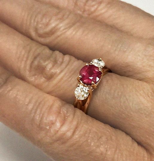 Sparkling ruby and diamond three-stone ring