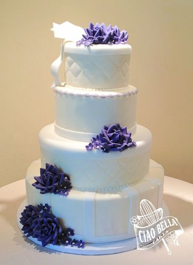 Four tier cake with purple flowers