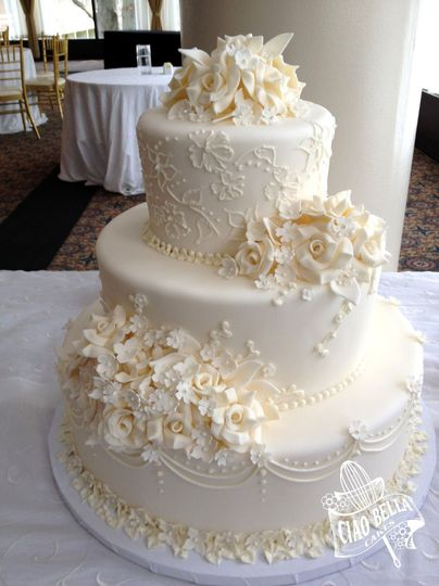 Three tier cake with white flowers