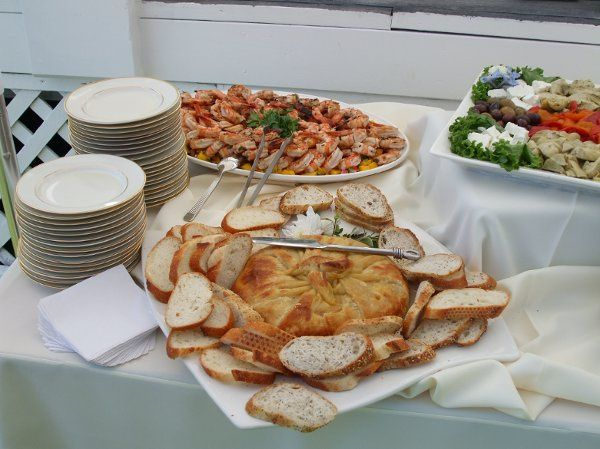 baked brie and roasted garlic in encroute and chilled grilled margarita marinated prawns with mango...