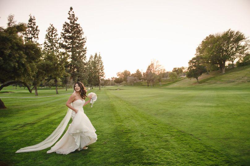 Bride running around the course