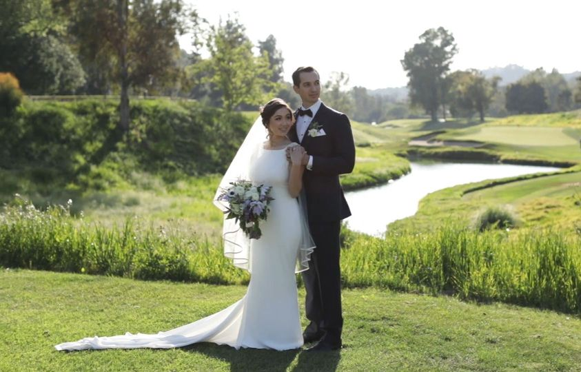 Portrait of the newlyweds by the course