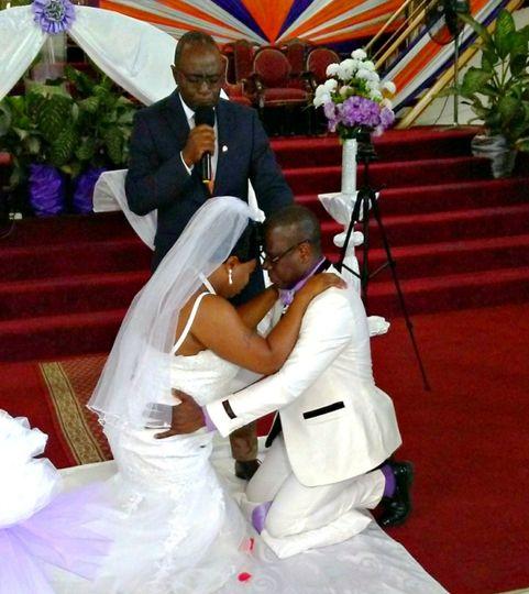 Couple kneeling for prayer