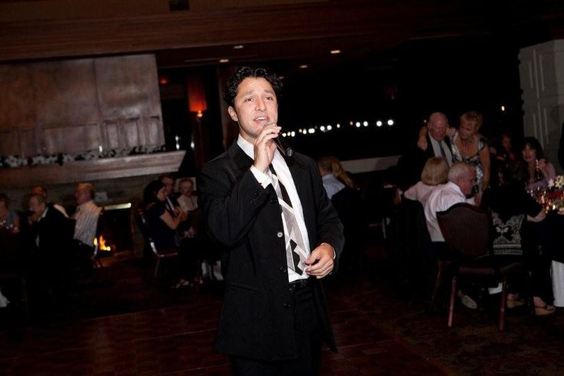 """DJ Val, formerly one of Frankie Valli's """"4 Seasons"""" serenades the party with a beautiful ballad."""