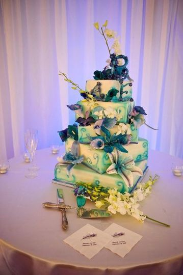 5 Tier White and Blue square spiraled wedding cake, with airbrushed details, sugar orchids and...