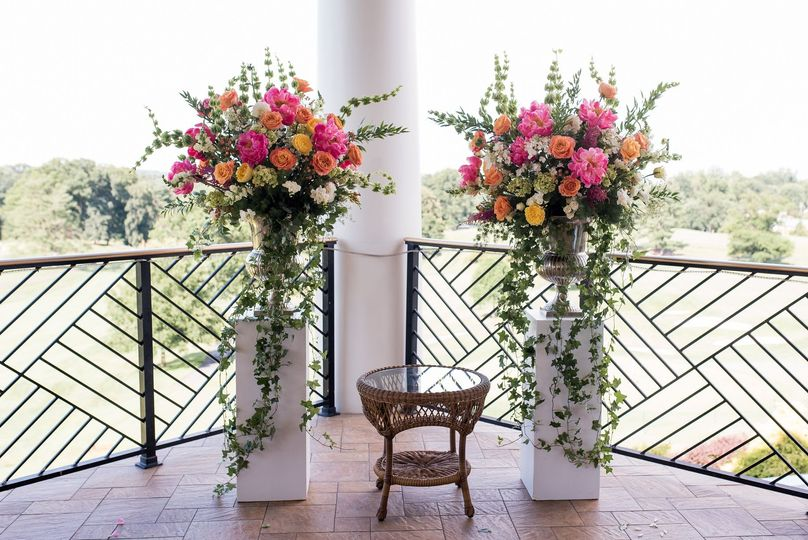 Ceremony flowers for a summer outdoor patio wedding at the Washington Golf and Country Club,...