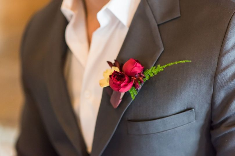 Boutonniere with dogwood blossoms and spray roses