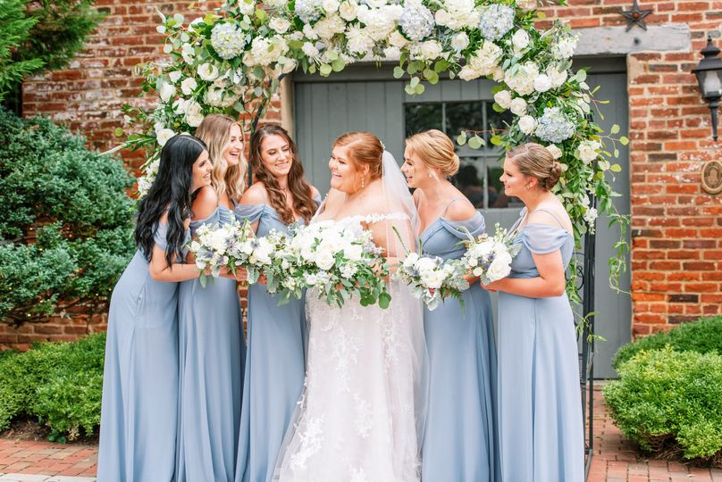 Bridal party in front of arch