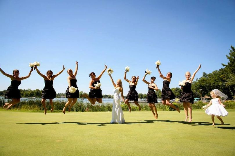 Jump shot of bridal party