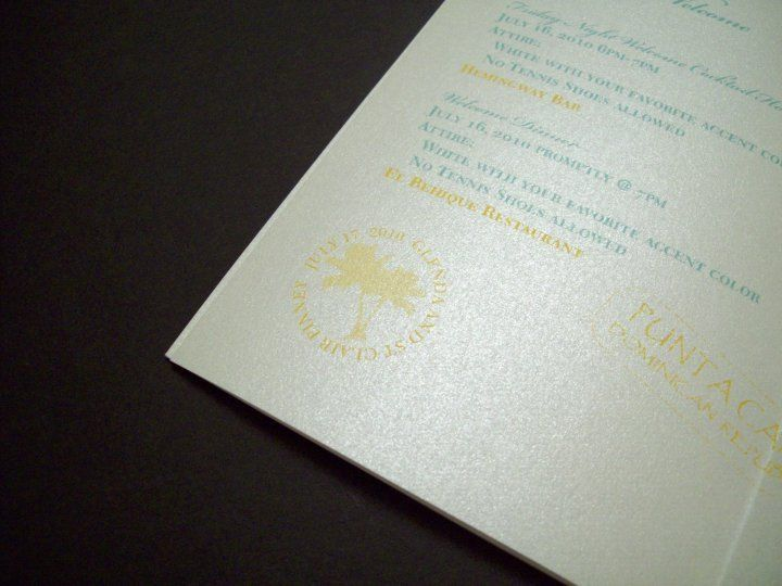 Passport invitation detail with custom stamps related to wedding.