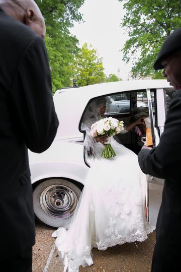 The bride getting in the car