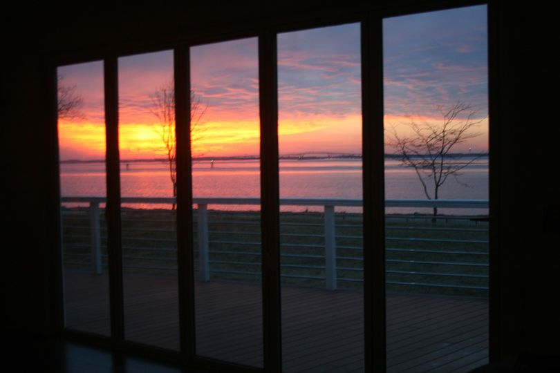 View of awesome sunset through one of the two large folding doors, opening up completely to the...