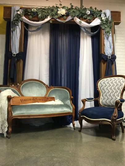 Rustic arch w/ victorian chair