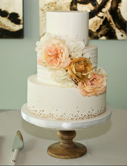Peach flowers decorating three tier cake