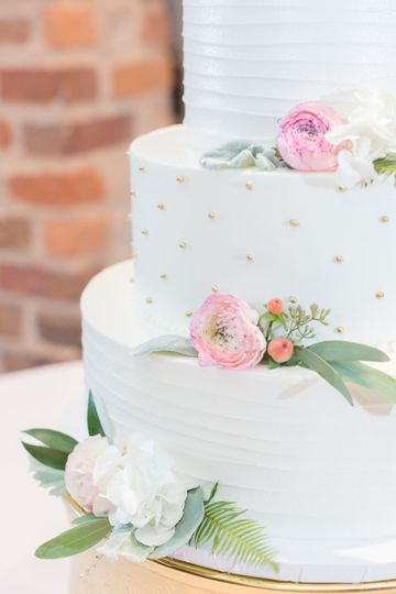 White cake with small flower decorations