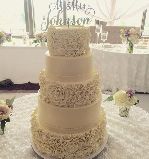 A white ruffle fondant and buttercream cake. We specialize in making our buttercream so smooth, it...