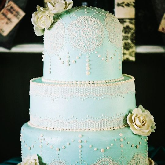 Blue domed cake in lace and pearls. The blue is all delicious buttercream!