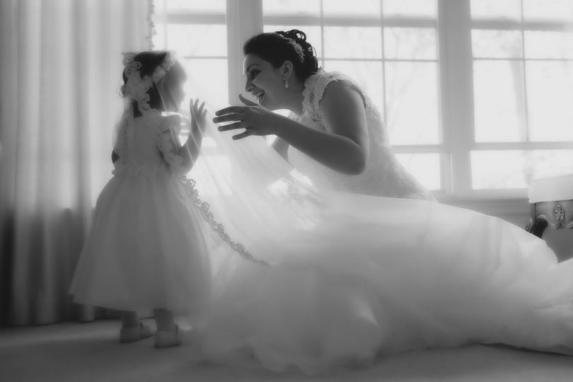 The Bride and Flower Girl, share a moment . . .