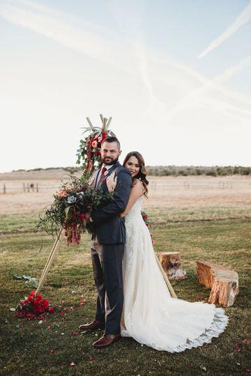 Newlyweds by the alfalfa fields