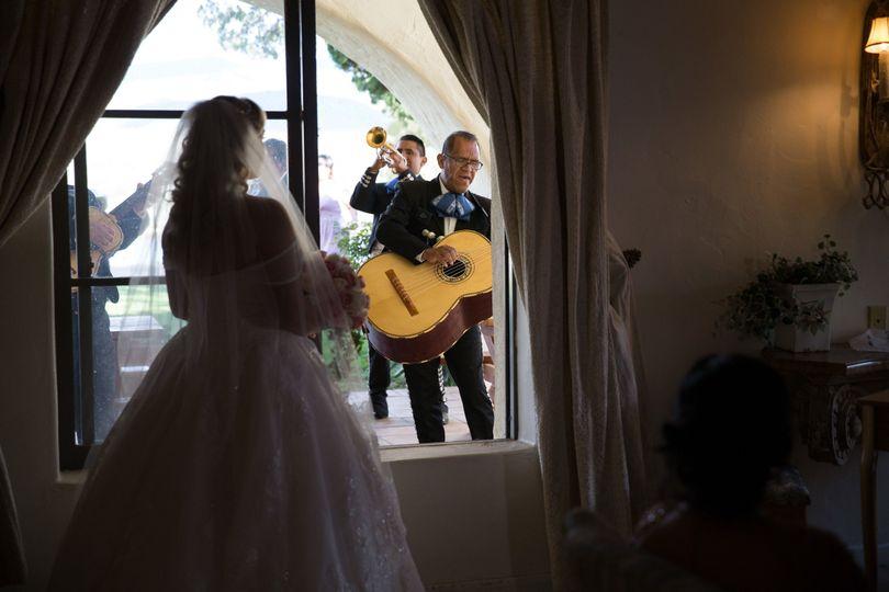 Wedding band serenading the bride