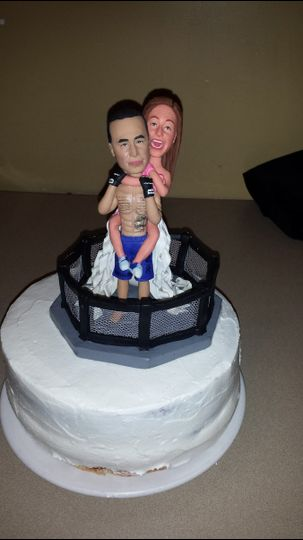 Custom wedding cake topper - Love this!  Edwin is an MMA fighter.  Create one that shows your style.