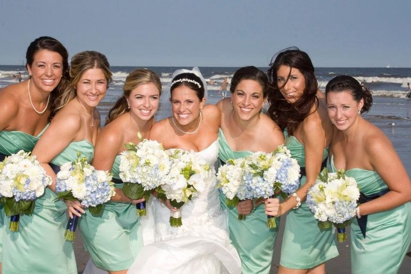 Beach shot of the bride and bridesmaids