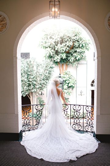 Bride standing at balcony