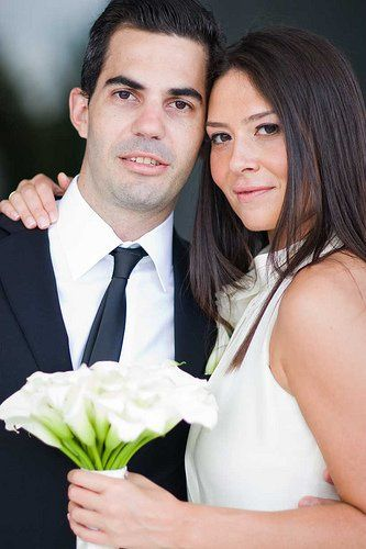 Glam wedding at the Ritz Carlton South Beach.  Bride and groom look stunning with their callas!