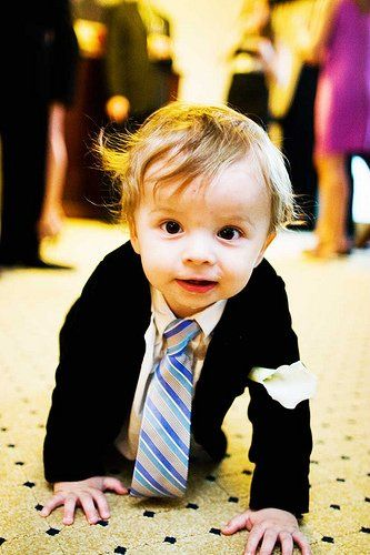 Glam wedding at the Ritz Carlton South Beach.  The tiny ring boy looks stunning with his calla bout!