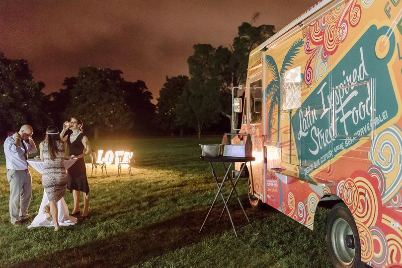 Cocktail tables and food truck