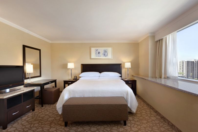 Bedroom of our mountain view corner suite with a king size bed.