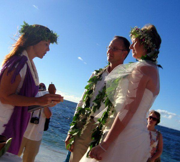 "Kahu Pomaikai'i presenting the couple with ""pa'akai"" (Hawaiian sea salt mixture) for personal..."